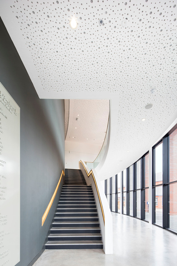 Wall and ceiling panels by Knauf. Architectural photography of Warwick Hall, for Ridgemount PR. Designed by Associated Architects